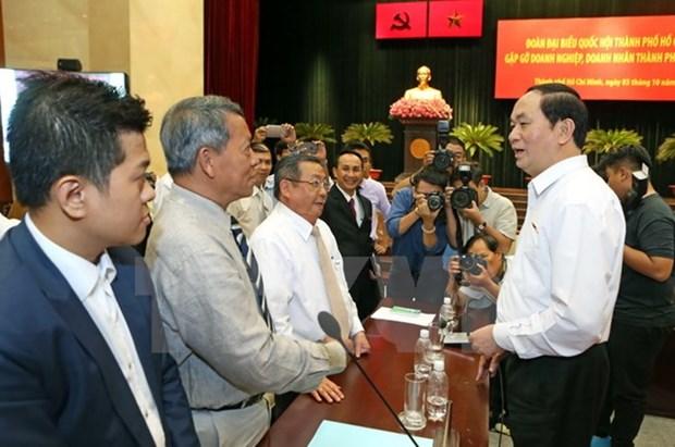 Le president Tran Dai Quang rencontre les entrepreneurs de Ho Chi Minh-Ville hinh anh 1