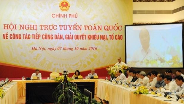 Le PM Nguyen Xuan Phuc a la conference nationale sur le reglement des plaintes hinh anh 1