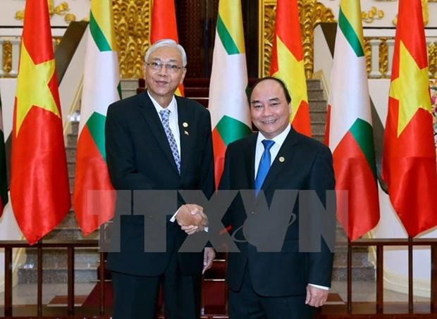 Le chef du PCV et le Premier ministre recoivent le president du Myanmar hinh anh 2
