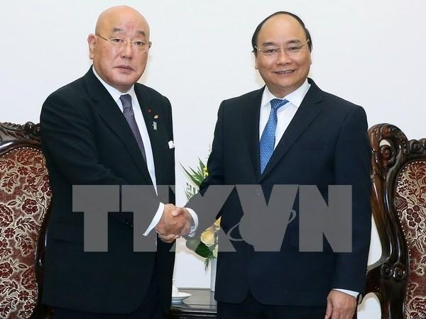 Nguyen Xuan Phuc recoit le conseiller special du gouvernement japonais hinh anh 1