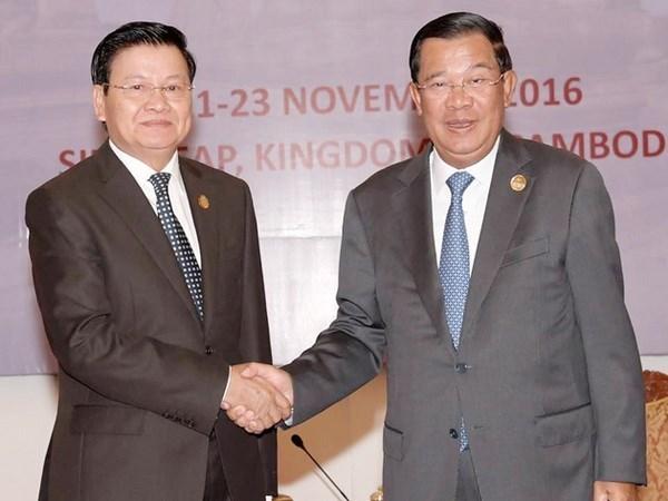 Inauguration de la nouvelle paire de portes frontalieres entre le Cambodge et le Laos hinh anh 1