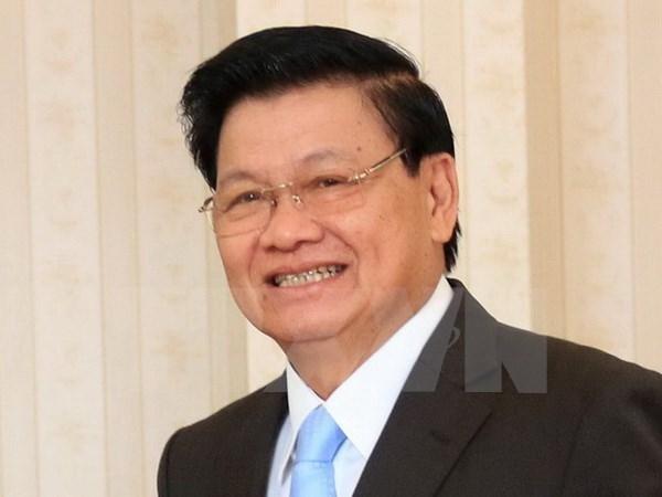 Le PM laotien arrive au Vietnam pour la 39e session du Comite intergouvernemental Vietnam-Laos hinh anh 1