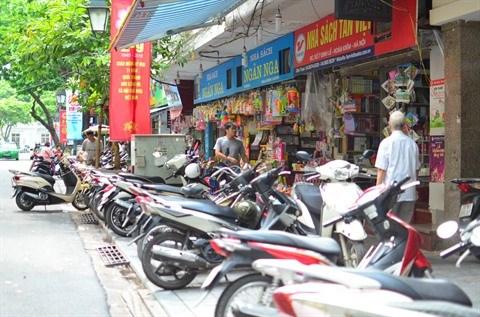 La rue des librairies Dinh Le et la lecture papier chez les jeunes hinh anh 1