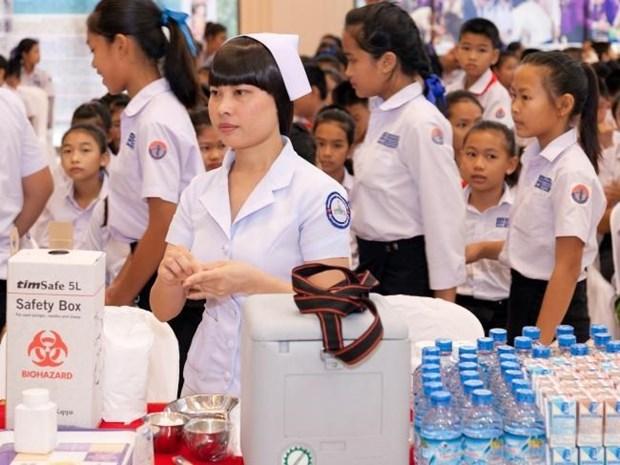 Le Laos fournit des soins de sante gratuits aux enfants hinh anh 1
