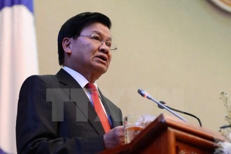 Le Premier ministre laotien visite Singapour hinh anh 1