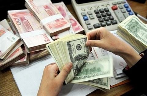 D'importantes pressions sur le taux de change hinh anh 1