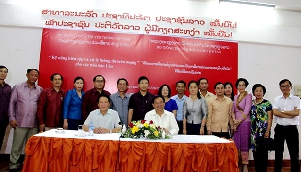 Assistance vietnamienne au Laos pour l'amelioration de la profession de journaliste hinh anh 1