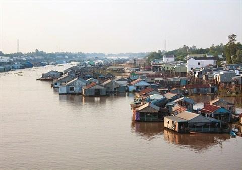 Le village piscicole en radeaux de Chau Doc hinh anh 1