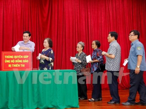 Typhon Doksuri : la communaute vietnamienne au Laos aux cotes des sinistres du Centre hinh anh 1