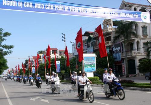 Meeting en echo de la Journee mondiale contre la rage a Bac Giang hinh anh 1