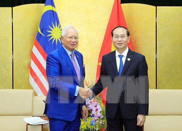 Tran Dai Quang rencontre des dirigeants des Philippines, du Myanmar et de Malaisie hinh anh 3
