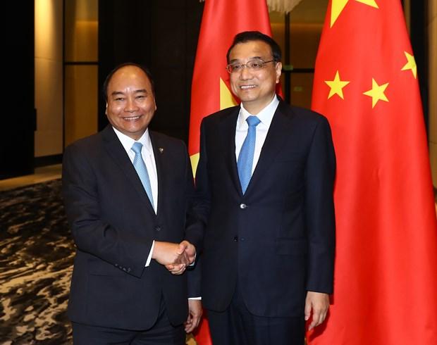 Sommet de l'ASEAN: le PM rencontre son homologue chinois hinh anh 1