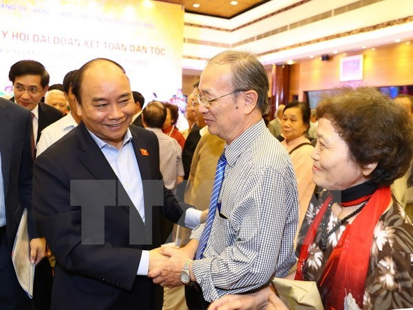 Le Premier ministre Nguyen Xuan Phuc a la fete de grande union nationale a Hanoi hinh anh 1