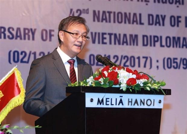 Felicitations pour la 42e Fete nationale du Laos hinh anh 1