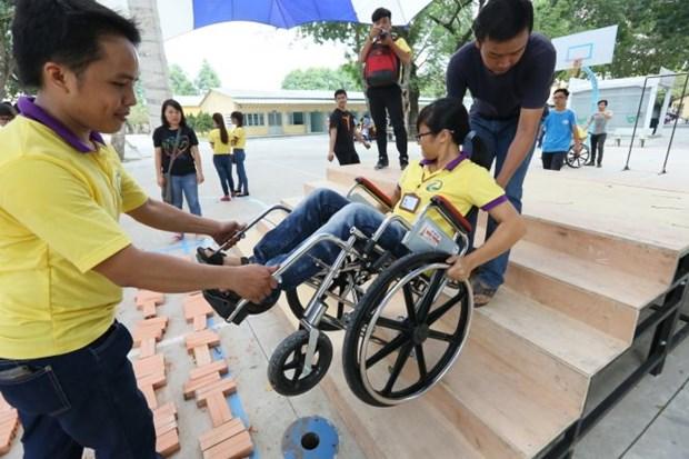 Pour mieux venir en aide aux handicapes hinh anh 1