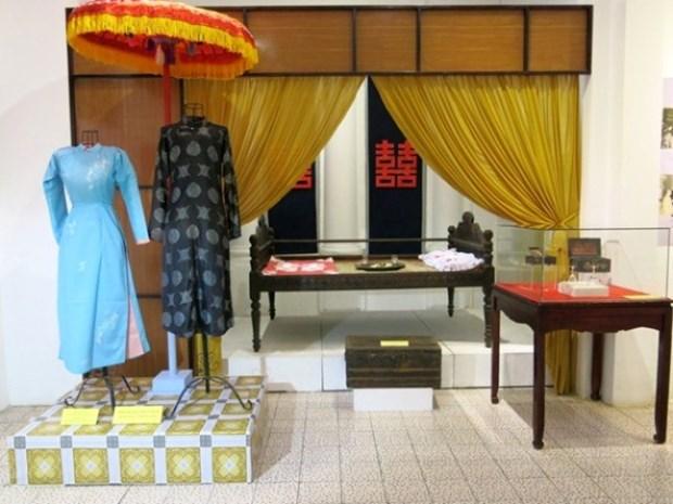 Exposition de photos et d'objets sur le mariage traditionnel de Hue hinh anh 2