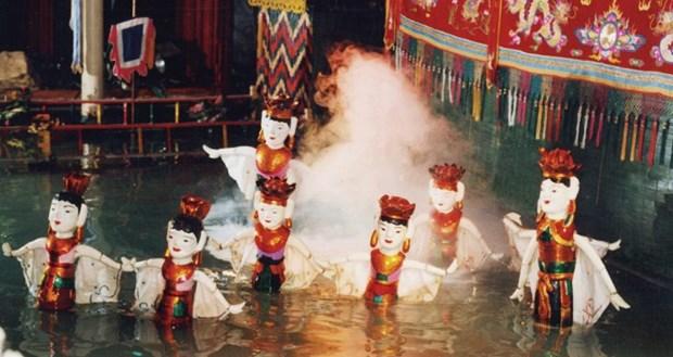 L'art des marionnettes sur l'eau du Vietnam seduisent les Francais hinh anh 1