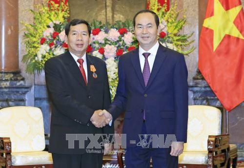 Le president vietnamien recoit le president de la Cour populaire supreme du Laos hinh anh 1