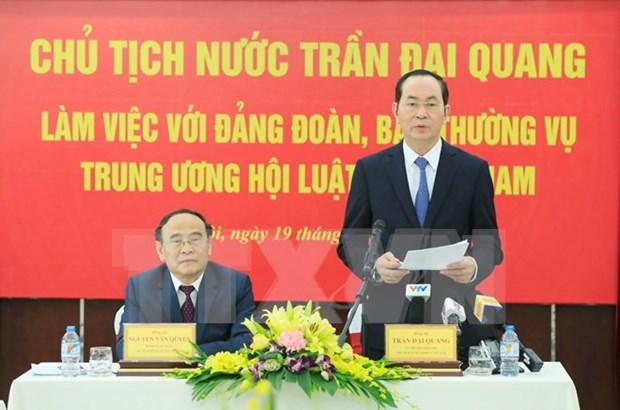 Le president Tran Dai Quang travaille avec l'Association des juristes du Vietnam hinh anh 1