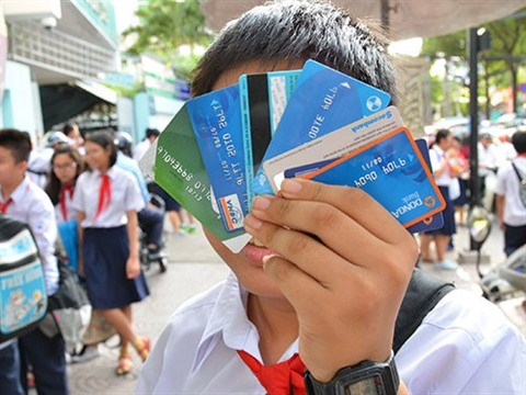 Acces aux cartes bancaires pour les enfants ages a partir de 15 ans hinh anh 1