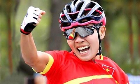 Nguyen Thi That, espoir de medaille d'or du Vietnam a l'ASIAD 18 hinh anh 2