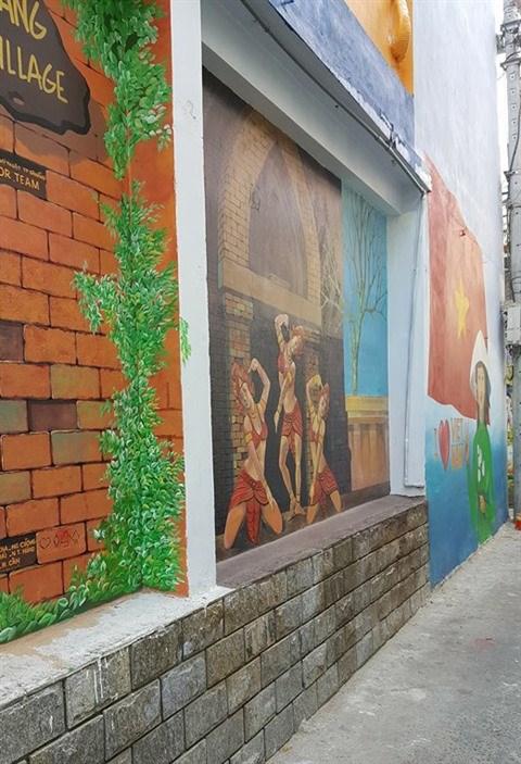 Da Nang: des fresques murales en plein cœur de la ville hinh anh 10