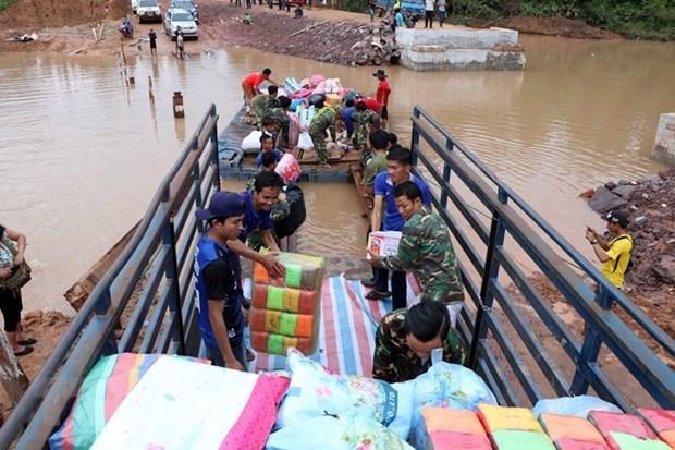 Effondrement d'un barrage au Laos : la Croix-Rouge vietnamienne aux cotes des victimes hinh anh 1