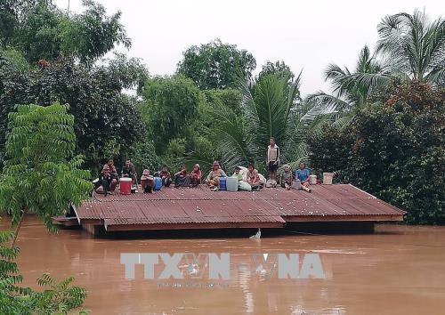 Barrage effondre au Laos: l'Armee populaire du Vietnam aux cotes des sinistres hinh anh 1