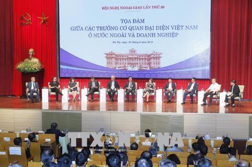 La diplomatie synchrone avec les entreprises durant le processus d'integration economique hinh anh 1