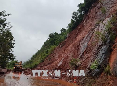 Dix morts suite aux pluies diluviennes causees par le typhon Bebinca hinh anh 1