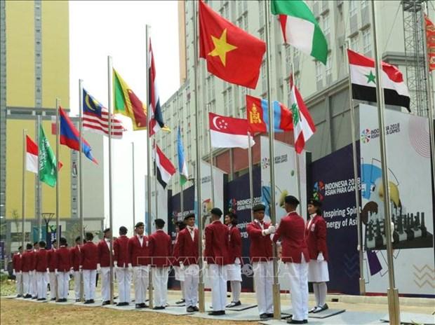 Asian ParaGames 2018 : Ceremonie de lever du drapeau de la delegation handisport vietnamienne hinh anh 1