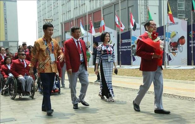 Asian ParaGames 2018 : Ceremonie de lever du drapeau de la delegation handisport vietnamienne hinh anh 2