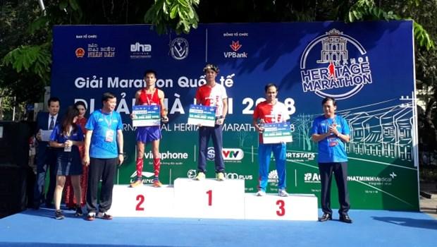 Plus de 2.600 sportifs courent a la decouverte du patrimoine de Hanoi hinh anh 1