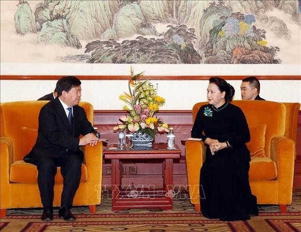 La presidente de l'AN Nguyen Thi Kim Ngan rencontre la communaute vietnamienne en Chine hinh anh 2