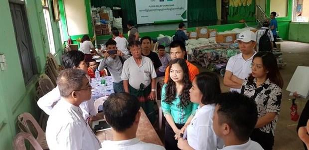 La communaute vietnamienne au Myanmar assiste des sinistres locaux des inondations hinh anh 2