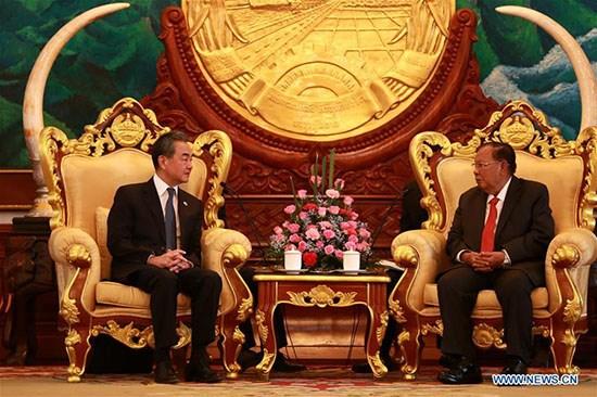 Le secretaire general du PPRL et president laotien recoit le ministre chinois des AE hinh anh 1