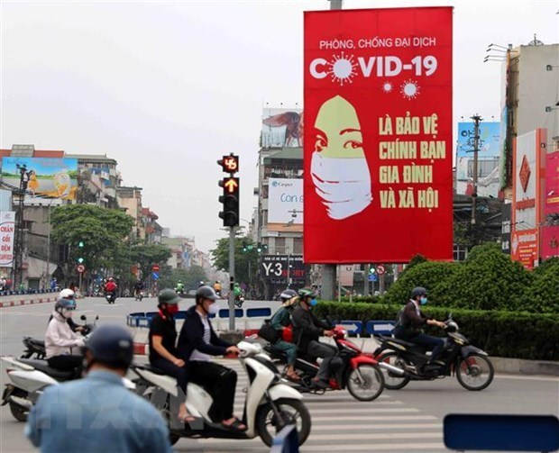 COVID-19 : la presse internationale salue l'efficacite du Vietnam hinh anh 1