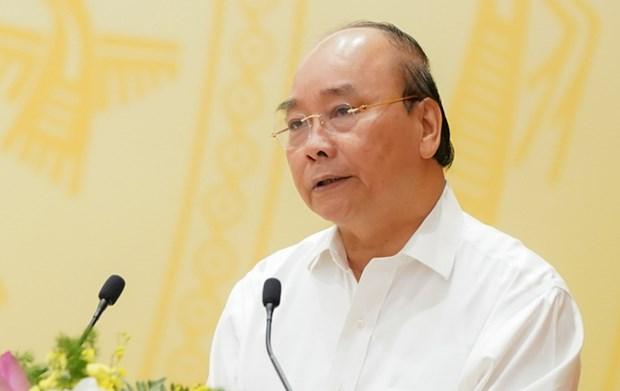 Le Premier ministre souligne la necessiste d'une reprise economique nationale hinh anh 2