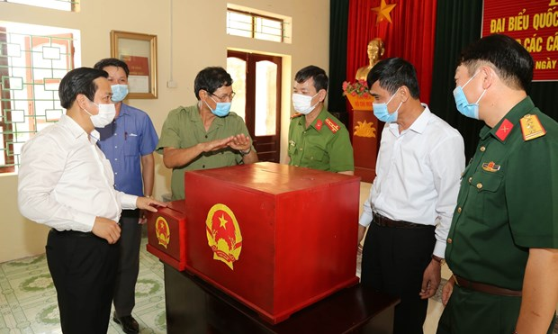 Le president de l'AN Vuong Dinh Hue preside la Conference nationale sur les elections legislatives hinh anh 1