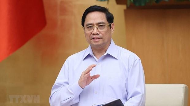 Le PM loue les contributions importantes des forces au front contre le COVID-19 hinh anh 1