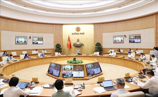 Le Premier ministre demande de trouver des solutions flexibles pour controler l'epidemie de Covid-19 hinh anh 2