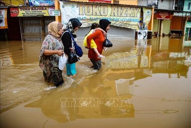 L'Indonesie decrete deux semaines d'etat d'urgence suite aux inondations hinh anh 1