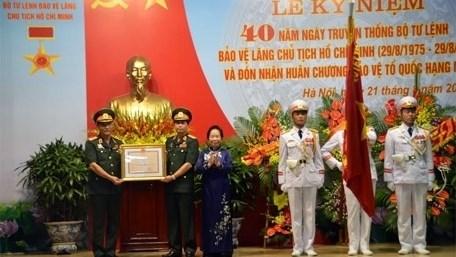 Celebration de la Journee traditionnelle de l'Unite protegeant le mausolee Ho Chi Minh hinh anh 1