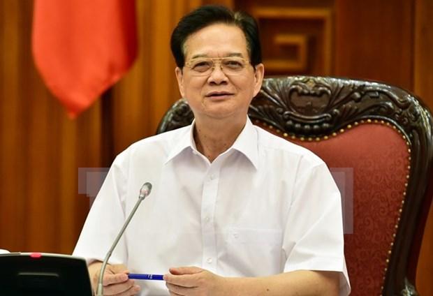 Le PM rencontre des investisseurs vietnamiens au Laos hinh anh 1