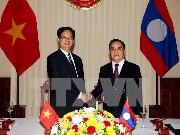 La visite du PM au Laos couronnee de succes hinh anh 1