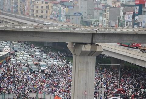 Forte pression du processus d'urbanisation sur les grandes villes hinh anh 3