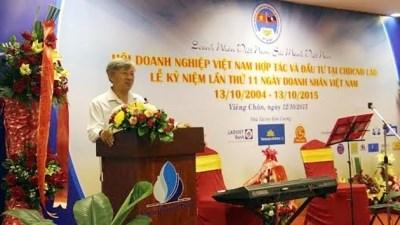 Celebration de la Journee des entrepreneurs vietnamiens au Laos hinh anh 1