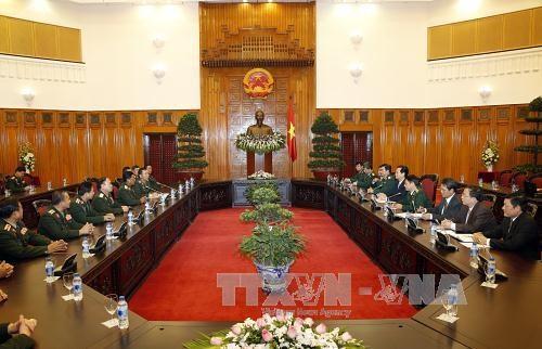 Le PM Nguyen Tan Dung rencontre le chef-d'etat major general de l'Armee laotienne hinh anh 1