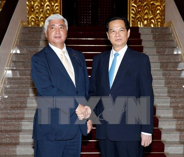 Des dirigeants recoivent le ministre japonais de la Defense hinh anh 2