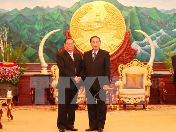 Un dirigeant vietnamien participe a la celebration de la Fete nationale au Laos hinh anh 1